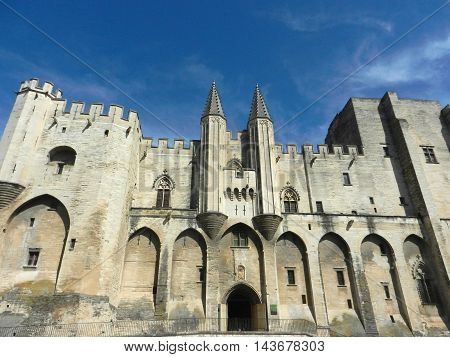 Facade of Palace des Papes in Avignon France with blue sky
