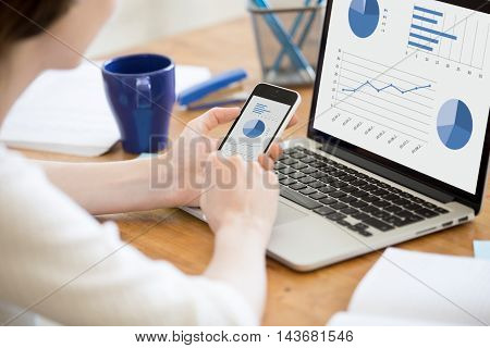 Young Office Woman Using Smartphone And Laptop. Close-up