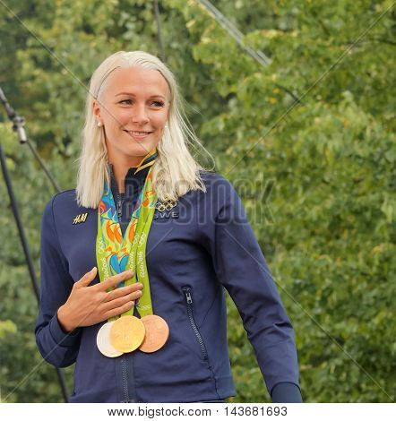 STOCKHOLM SWEDEN - AUG 21 2016: Famous swimmer Sarah Sjostrom showing her medals from the olympic games when the swedish olympics are celebrated in Kungstradgarden Stockholm Sweden August 21 2016