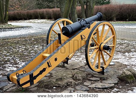 old military cannon, napoleonic weapon in winter