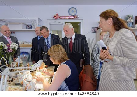 ST. PETERSBURG, RUSSIA - AUGUST 9, 2016: Vice-governor of St. Petersburg Igor Divinsky (center) during his working visit to the Imperial Porcelain Manufactory. The enterprise was founded in 1744