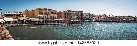 CHANIA, CRETE - JULY 2016: Panorama of Chania harbour with traditional venetian architecture