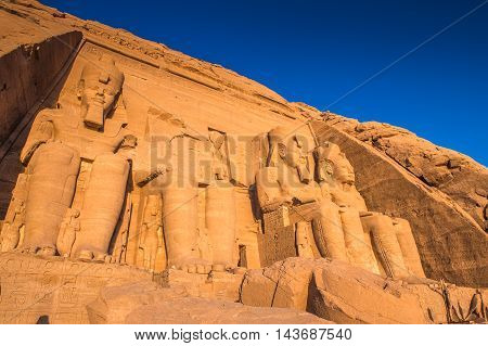 Colossus of The Great Temple of Ramesses II on sunrise, Abu Simbel, Egypt