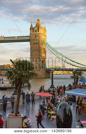 LONDON, UK - SEPTEMBER 20, 2015: Thames embankment with lots of walking people and tourists