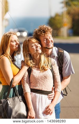 Three Happy Young People Friends Outdoor.