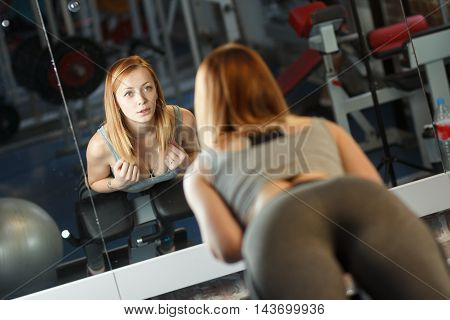 Concept: sport, healthy lifestyle. Young strong girl do exercises in gym