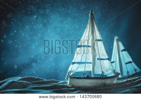 Antique sail boat Toy model with rope on sand