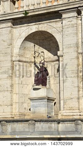 Ancient marble and porphyry statue of Minerva as Goddess Rome fountain in Capitol Square Rome
