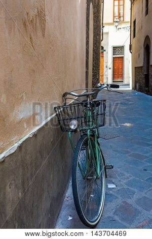 Old Bicycle In An Alley Of Florence