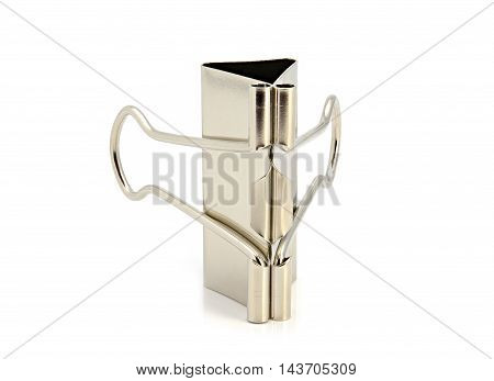 Silver binder clips for paper on a white background