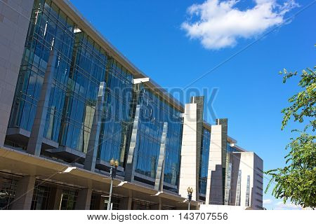 WASHINGTON DC USA - JUNE 8 2016: Washington Convention Center facade under a blue summer sky in Washington DC on June 8 2016. The building named in honor of the city mayor the late Walter E. Washington.