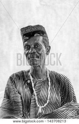 KARA, TOGO - MAR 9, 2013: Unidentified Togolese man in the traditional clothes. People in Togo suffer of poverty due to the unstable econimic situation