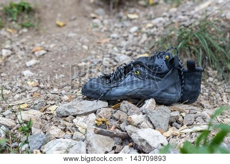 Pair of black climbing shoes on ground
