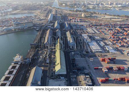 Long Beach, California, USA - August 16, 2016:  Aerial view of industrial waterfront pier in Long Beach, California.