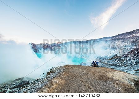 KAWAH IJEN, INDONESIA - 14 AUG - Unidentified travelers group taking a selfie at top of Kawah Ijen mountain, in Indonesia on August 14, 2016