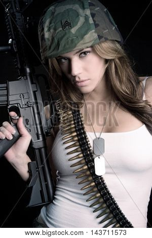 Woman holding military automatic rifle gun