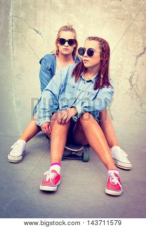 Two beautiful skater girl friends