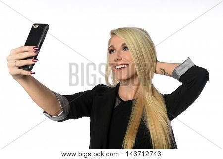 Beautiful businesswoman taking selfie isolated over white background