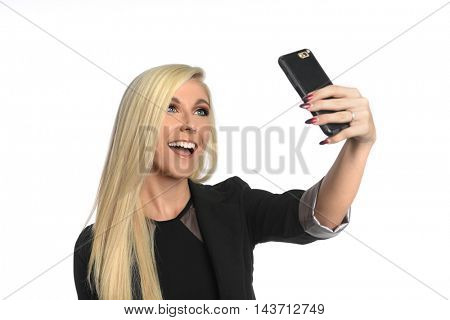 Portrait of beautiful young businesswoman taking selfie isolated over white background