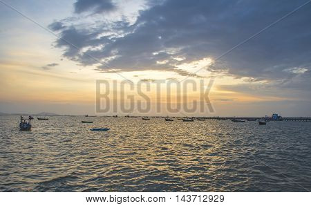 Landscape with sunset at the seashore and beautiful sky, Bangpha, Thailand