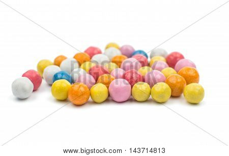 color dragee dessert on a white background
