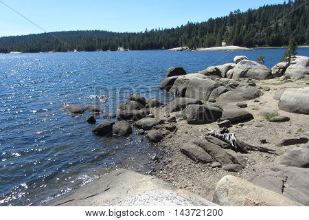 rocky shore of pristine Lake Alpine, Highway 4, Sierra Nevada Mountains, California