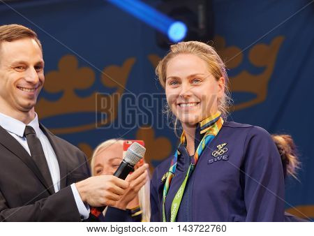STOCKHOLM SWEDEN - AUG 21 2016: Swedish soccer player Lisa Dahlkvist winning olympic silver smiling when the swedish olympic athletes are celebrated in Kungstradgarden Stockholm Sweden August 212016