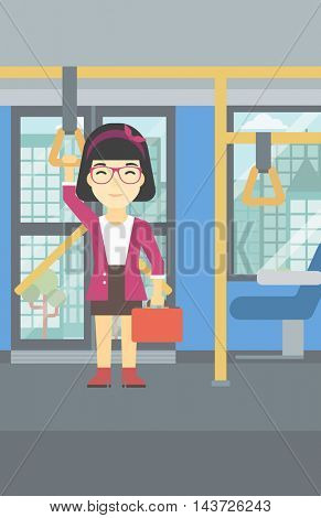 An asian woman traveling by public transport. Young woman standing inside public transport. Woman traveling by passenger bus or subway. Vector flat design illustration. Vertical layout.