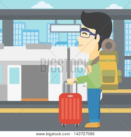 An asian young man standing at the train station on the background of train with open doors. Young man with suitcase waiting for a train. Vector flat design illustration. Square layout.