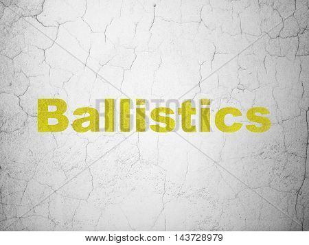 Science concept: Yellow Ballistics on textured concrete wall background