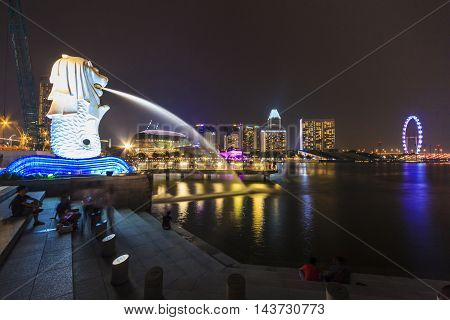 SINGAPORE SINGAPORE - SEPTEMBER 28 2013 : Night view of The Merlion Singapore flyer located at Marina Bay a famous tourist attractions in Singapore.
