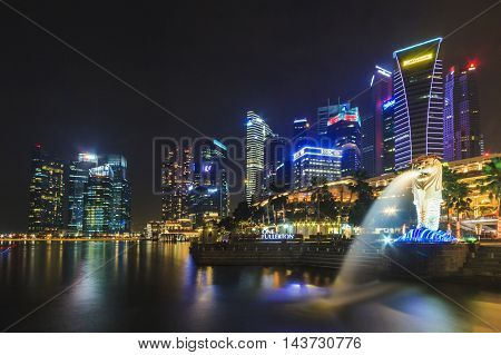SINGAPORE SINGAPORE - SEPTEMBER 28 2013 : Night view of The Merlion located at Marina Bay a famous tourist attractions in Singapore.