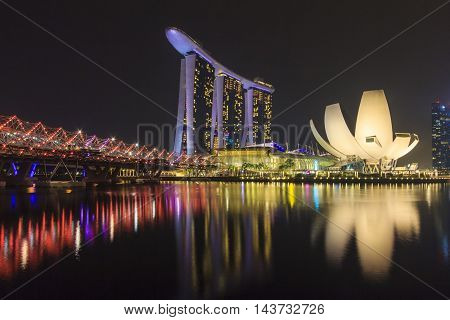 SINGAPORE SINGAPORE - SEPTEMBER 28 2013 : Singapore skyline and view of Marina Bay Sands luxury hotel which located near Helix bridge a famous landmark of Singapore