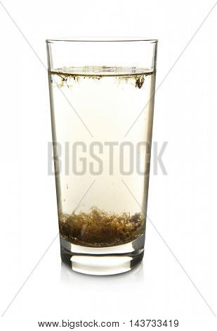 Glass of contaminated water isolated on white