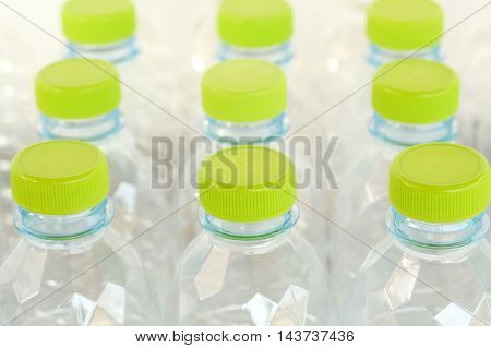 side view of white plastic bottle with green lid