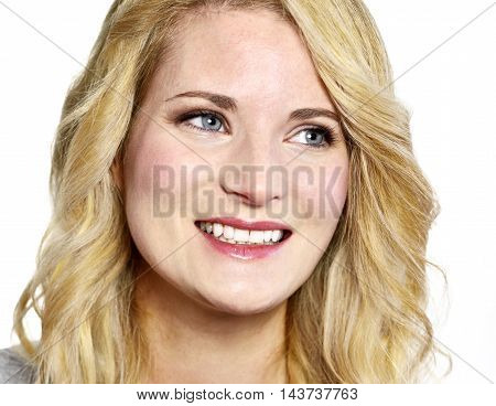 Blond woman with curly, blond hair, smiling.