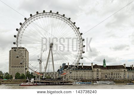 LONDON UNITED KINGDOM - JULY 8 2016: The London Eye - giant Ferris wheel on the South Bank of the River Thames. The entire structure is 135 metres tall and the wheel has a diameter of 120 metres.