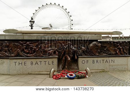 LONDON UK - JULY 8 2016: The Battle of Britain Memorial on the Victoria Embankment a 25m-long bronze monument commemorating the pilots who died during WWII's Battle of Britain.
