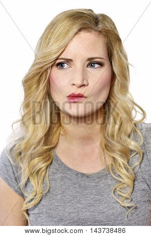 Blond woman with curly, blond hair, thinking looking.