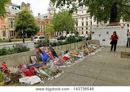 LONDON UK - JULY 8 2016: Tribute on Parliament Square in remembrance to British politician Jo Cox who was killed in Birstall West Yorkshire.