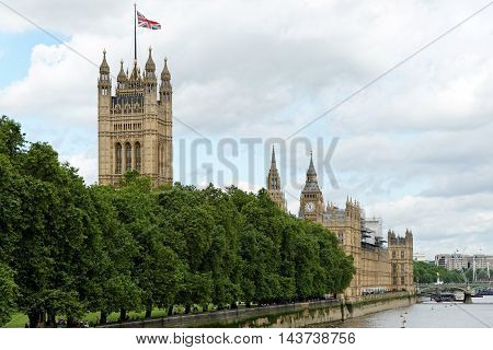 River Thames and Palace of Westminster (known as Houses of Parliament). Palace of Westminster located on bank of River Thames in City of Westminster London. UK.