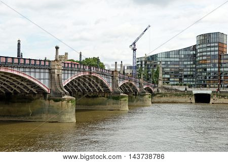 Lambet bridge over river Thames in London England. It is a five span steel arch bridge that is Grade II Listed. Its predecessor was a horse-ferry.