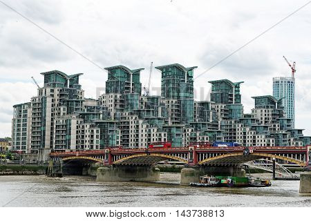 LONDON ENGLAND - JULY 8 2016: St George Wharf - a mixed-use riverside development in Lambeth located on the southern bank of the River Thames beside Vauxhall Bridge.