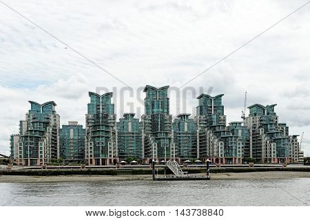 LONDN ENGLAND - JULY 8 2016: St George Wharf - a riverside development in Lambeth located on the southern bank of the River Thames beside Vauxhall Bridge.