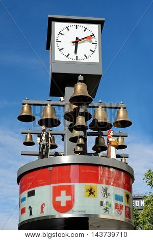 LONDON ENGLAND - JULY 8 2016: View of Swiss glockenspiel clock (erected 1985) on Leicester Square. Under the clock there are 27 bells and figures of traditional Swiss Alpine farmers.