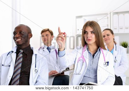 Group Of Doctors Listen Some Presentation