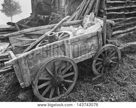Old wooden cart for transport of hay - black and white
