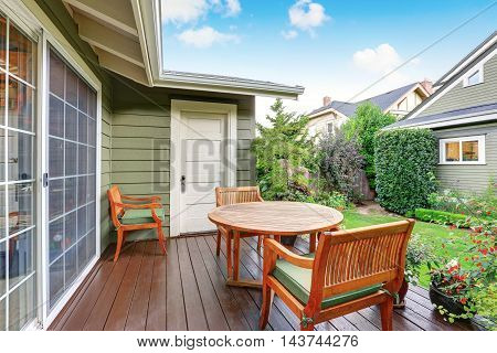 Back Deck Of Guest House With Wooden Table Set