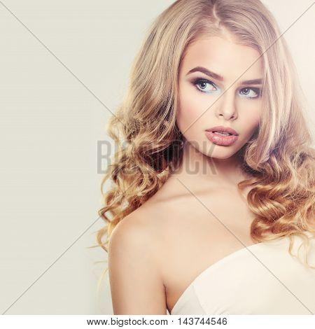 Beautiful Blonde Woman with Long Wavy Hair