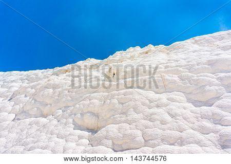 White wall on travertines Pamukkale in Turkey